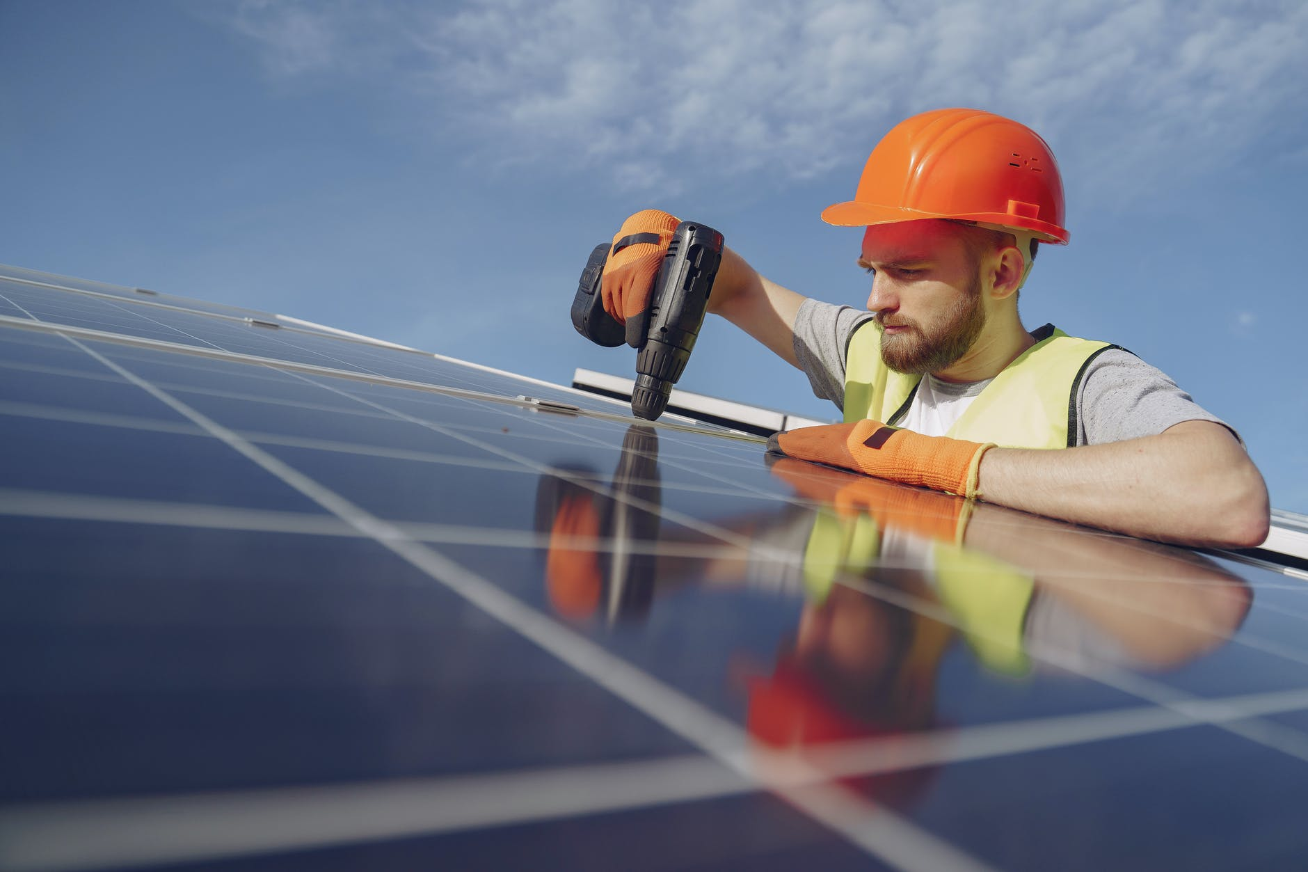 focused young professional engineer installing solar panel